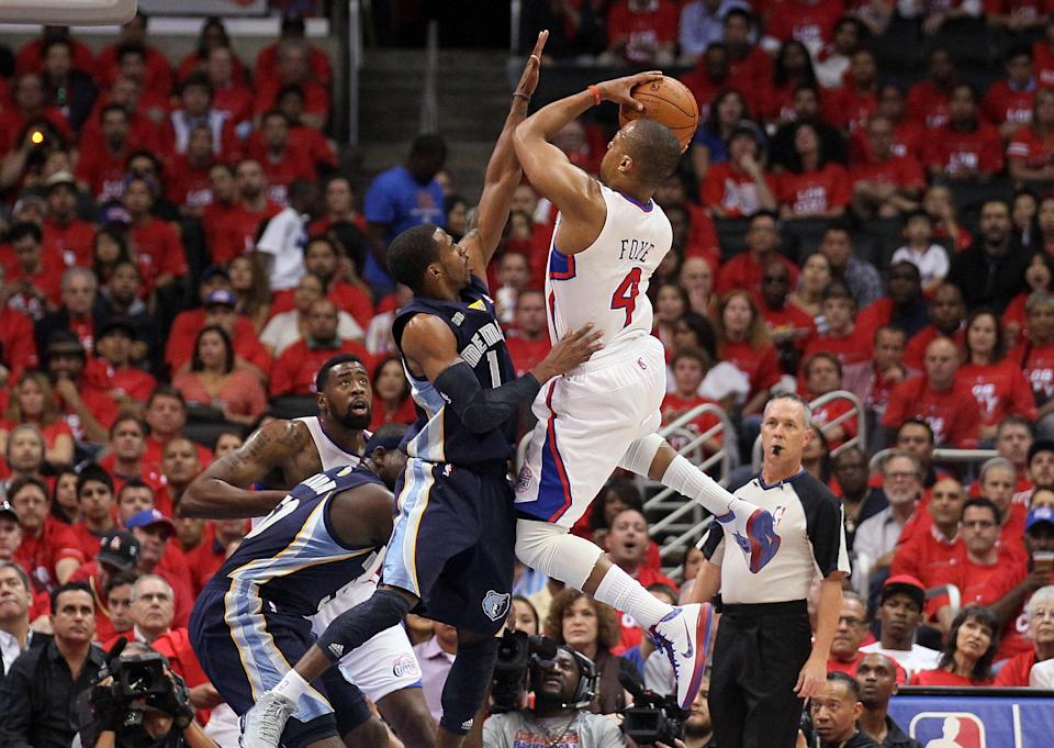 LOS ANGELES, CA - MAY 11: Randy Foye #4 of the Los Angeles Clippers shoots the ball over Mike Conley #11 of the Memphis Grizzlies in the first quarter of Game Six of the Western Conference Quarterfinals in the 2012 NBA Playoffs on May 11, 2012 at Staples Center in Los Angeles, California. NOTE TO USER: User expressly acknowledges and agrees that, by downloading and or using this photograph, User is consenting to the terms and conditions of the Getty Images License Agreement. (Photo by Stephen Dunn/Getty Images)