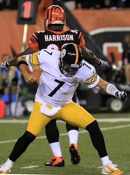 Pittsburgh Steelers quarterback Ben Roethlisberger (7) pumps his fist after throwing a one-yard touchdown pass against the Cincinnati Bengals in the first half of an NFL football game, Monday, Sept. 16, 2013, in Cincinnati. Outside linebacker James Harrison looks to the end zone. (AP Photo/Tom Uhlman)