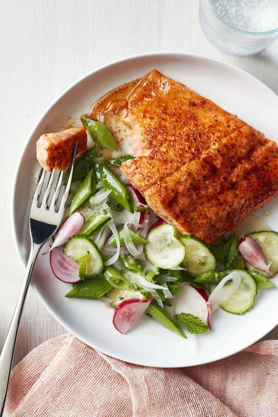 """<p>All health-minded moms will appreciate this light seafood dinner, which is paired with a refreshing side salad on Mother's Day. </p><p><a href=""""https://www.womansday.com/food-recipes/food-drinks/recipes/a58512/roasted-blackened-salmon-snap-pea-salad-recipe/"""" rel=""""nofollow noopener"""" target=""""_blank"""" data-ylk=""""slk:Get the recipe for Roasted Blackened Salmon with Snap Pea Salad."""" class=""""link rapid-noclick-resp""""><em>Get the recipe for Roasted Blackened Salmon with Snap Pea Salad.</em></a> </p>"""