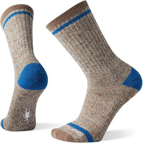 """<h2>SmartWool Larimer Sock<br></h2><br>Merino wool is seriously a miracle fiber, and its moisture-wicking properties make it the perfect material for socks. SmartWool's rugged hiker-style has just the right combination of aesthetics and function for someone who is picky about everything he puts on his body — even socks.<br><br><em>Shop Smartwool at<strong> <a href=""""https://www.rei.com/b/smartwool"""" rel=""""nofollow noopener"""" target=""""_blank"""" data-ylk=""""slk:REI"""" class=""""link rapid-noclick-resp"""">REI</a></strong></em><br><br><strong>Smartwool</strong> Larimer Socks, $, available at <a href=""""https://go.skimresources.com/?id=30283X879131&url=https%3A%2F%2Fwww.rei.com%2Fproduct%2F887267%2Fsmartwool-larimer-socks-mens"""" rel=""""nofollow noopener"""" target=""""_blank"""" data-ylk=""""slk:REI"""" class=""""link rapid-noclick-resp"""">REI</a>"""