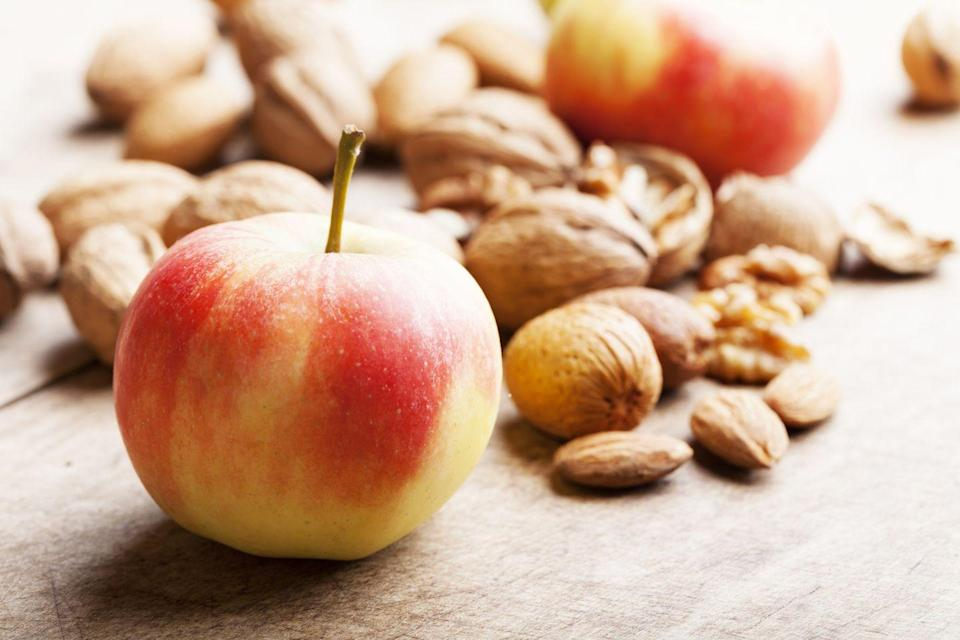 """<p><strong>We like to call fruit nature's candy; it's packed with wholesome fiber and tons of natural nutrients.</strong> If you can't go for a full piece of fruit, opt for something small like little clementines or <a href=""""https://go.redirectingat.com?id=74968X1596630&url=https%3A%2F%2Fwww.walmart.com%2Fip%2FRockit-Apples-3-lb-Tub%2F309762096&sref=https%3A%2F%2Fwww.redbookmag.com%2Ffood-recipes%2Fg34585100%2Fhealthy-snack1%2F"""" rel=""""nofollow noopener"""" target=""""_blank"""" data-ylk=""""slk:miniature Rockit apples"""" class=""""link rapid-noclick-resp"""">miniature Rockit apples</a>. These mini fruit options are also a great healthy snack for kids. Add a handful of nuts for added protein to help keep you full.</p>"""