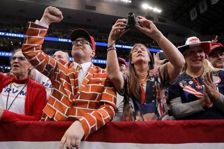 A man dressed as a wall cheers in the front row as U.S. President Donald Trump rallies with supporters in Dallas, Texas