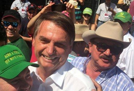 Nabhan Garcia (R), the head of farmers group, is seen next to Jair Bolsonaro, far-right lawmaker and presidential candidate of the Social Liberal Party (PSL) in Ribeirao Preto, Brazil April 30, 2018. REUTERS/Marcelo Teixeira