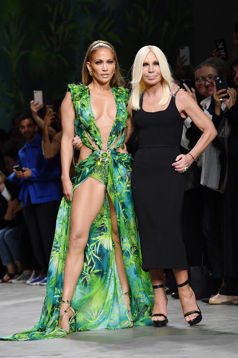 Jennifer Lopez (L) and Donatella Versace (R) appeared at the 2019 Versace show during Milan Fashion Week with Lopez sporting a newer version of the famous green dress. (Photo: Jacopo Raule/Getty Images)