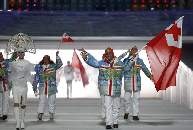 Tonga's flag-bearer Bruno Banani leads his country's contingent during the opening ceremony of the 2014 Sochi Winter Olympics, February 7, 2014. REUTERS/Phil Noble (RUSSIA - Tags: OLYMPICS SPORT)