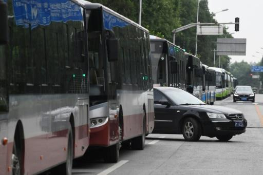 Petitioners were marched on to public buses that lined the roads around the China Banking Regulatory Commission, where the protest was to occur, and driven away under police escort