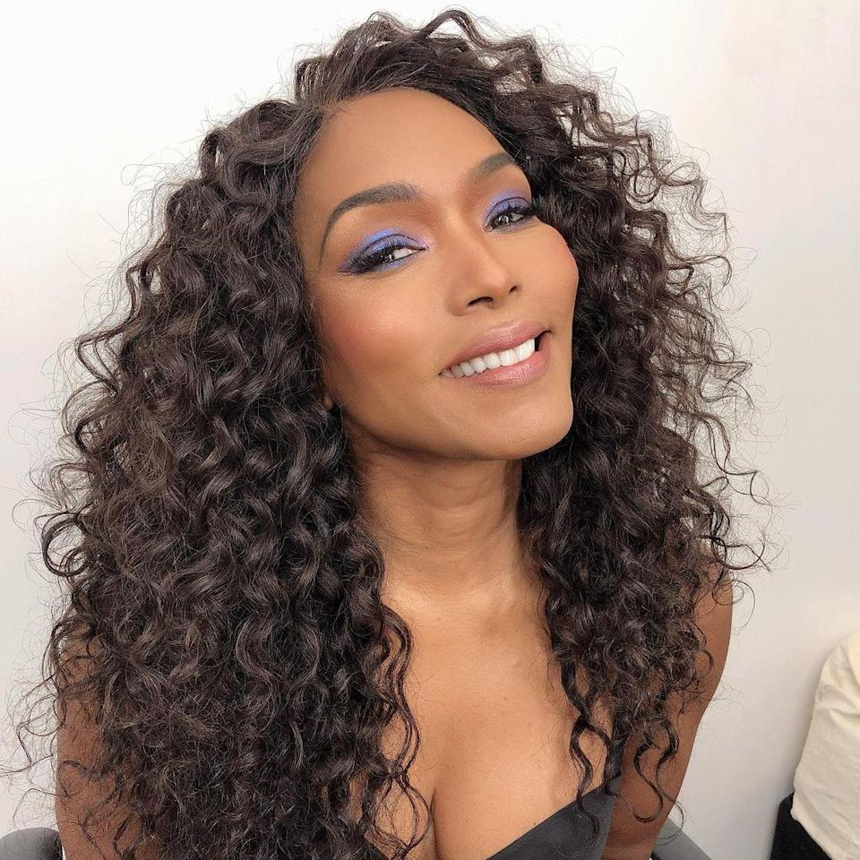Full, voluminous curls are the epitome of glam, especially when paired with some killer blue eyeshadow.