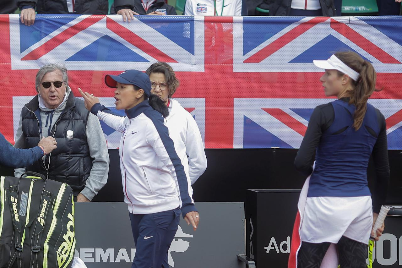 Great Britain's head coach Anne Keothavong gestures towards Romania's head coach Ilie Nastase during the FedCup Group II play-off match between Romania and Great Britain, in Constanta county, Romania, April 22, 2017. Inquam Photos/George Calin/via REUTERS             ATTENTION EDITORS - THIS IMAGE WAS PROVIDED BY A THIRD PARTY. EDITORIAL USE ONLY. ROMANIA OUT. NO COMMERCIAL OR EDITORIAL SALES IN ROMANIA.    TPX IMAGES OF THE DAY