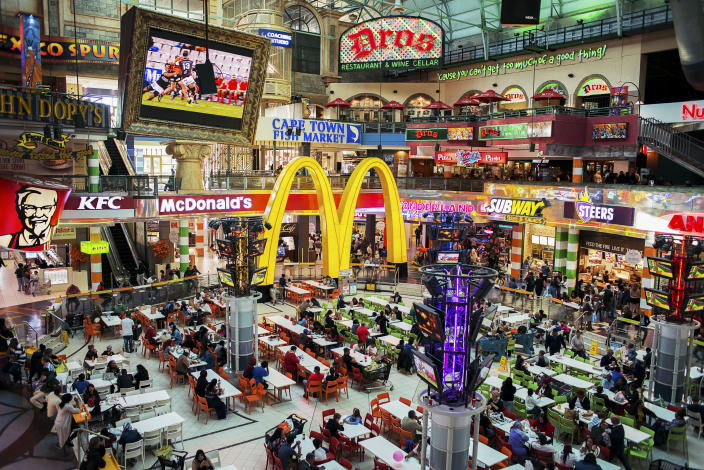 <p>The food court of Canal Walk, one of the largest shopping centers in the suburbs of Cape Town. Adult obesity is more common globally than malnutrition, and the worldwide prevalence of obesity more than doubled between 1980 and 2014. According to the WHO data, there are around 1.9 billion adults overweight, of those 600 million are considered obese. (Photograph by Silvia Landi) </p>