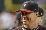 Arizona Diamondbacks manager Torey Lovullo laughs in his dugout as his team battles against the San Diego Padres during the first inning of a baseball game Sunday, Sept. 29, 2019, in Phoenix. (AP Photo/Darryl Webb)