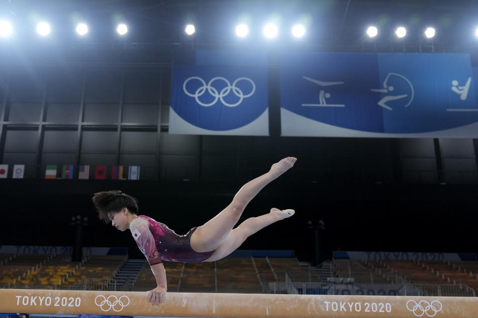 FILE - In this July 25, 2021, file photo, , of Japan, performs on the balance beam during the women's artistic gymnastic qualifications at the 2020 Summer Olympics, in Tokyo. Murakami said she was thrilled that her home country hosted the Olympics because she hoped many of her admirers could see her perform in person. She was devasted when even Japanese citizens were barred from attending. (AP Photo/Natacha Pisarenko, File)