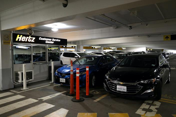 Car sit idle at the Hertz Rent-A-Car rental lot at San Francisco International Airport on April 30, 2020 in San Francisco, California.