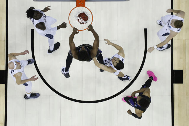 <p>Noah Dickerson #15 of Washington Huskies dunks between Neemias Queta #23, Brock Miller #22 and Abel Porter #15 of the Utah State Aggies in the first round of the 2019 NCAA Men's Basketball Tournament held at Nationwide Arena on March 22, 2019 in Columbus, Ohio. </p>
