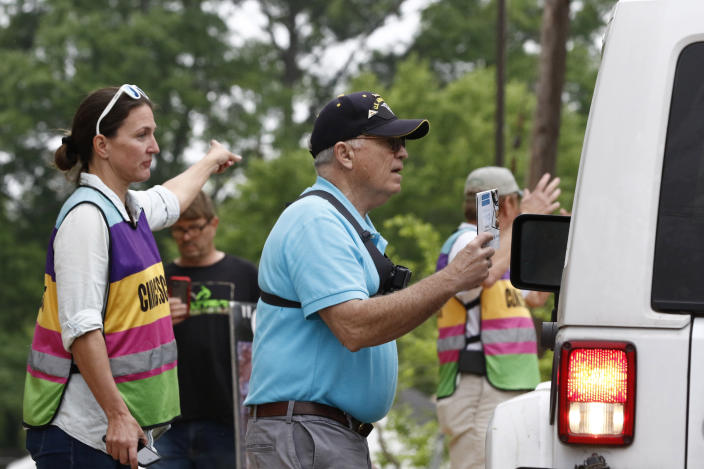 David Lane, right, an anti-abortion activist pleads with a driver and the patient to drive away and hold off having an abortion, to women as they are directed by clinic escort Scotta Brady to the parking lot of the Women's Health Organization clinic, Wednesday, March 25, 2020, in Jackson, Miss. The clinic is Mississippi's only state licensed abortion facility. Gov. Tate Reeves told reporters at a press conference on the coronavirus Tuesday that he considers abortion an elective and unnecessary procedure. (AP Photo/Rogelio V. Solis)