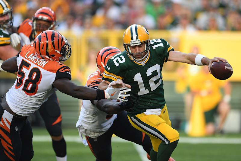 GREEN BAY, WI - SEPTEMBER 24: Aaron Rodgers #12 of the Green Bay Packers is sacked by Carl Lawson #58 and Chris Smith #94 of the Cincinnati Bengals during the third quarter at Lambeau Field on September 24, 2017 in Green Bay, Wisconsin. (Photo by Stacy Revere/Getty Images)
