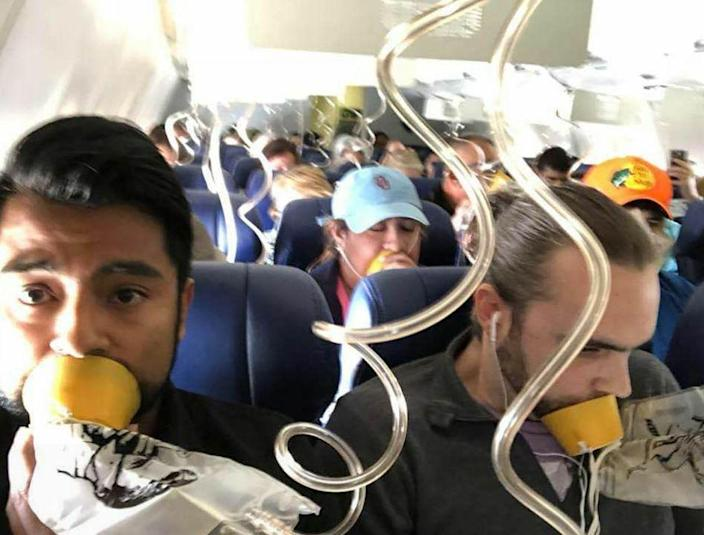 Most of the people pictured are wearing their oxygen masks incorrectly (Twitter)