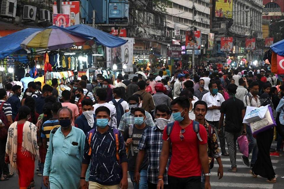 People gather in a market ahead of the Hindu festival 'Durga Puja' in Kolkata (AFP via Getty Images)