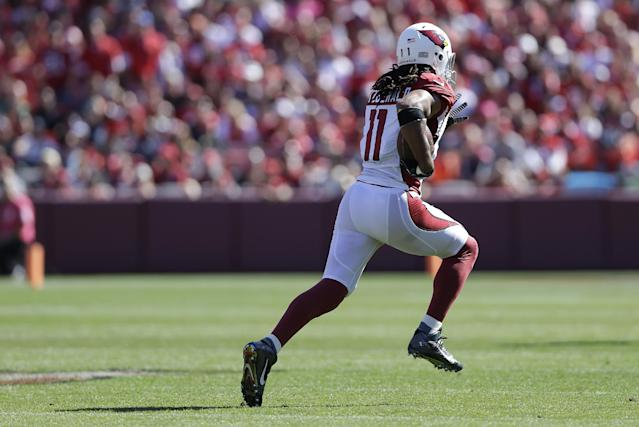Arizona Cardinals wide receiver Larry Fitzgerald (11) runs on a 75-yard touchdown reception against the San Francisco 49ers during the first quarter of an NFL football game in San Francisco, Sunday, Oct. 13, 2013. (AP Photo/Marcio Jose Sanchez)