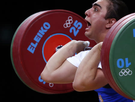 FILE PHOTO: Armenia's Meline Daluzyan competes on the women's 69Kg Group A weightlifting competition at the ExCel venue at the London 2012 Olympic Games August 1, 2012. REUTERS/Grigory Dukor