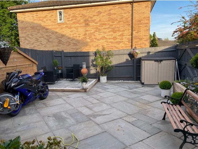 """<p>With plenty of TLC, it now looks like the perfect spot to unwind. Giving it a refresh, Sharon added slabs, built raised planters and painted the fence an on-trend grey. </p><p><strong>Follow House Beautiful on <a href=""""https://www.instagram.com/housebeautifuluk/"""" rel=""""nofollow noopener"""" target=""""_blank"""" data-ylk=""""slk:Instagram"""" class=""""link rapid-noclick-resp"""">Instagram</a>.</strong></p>"""
