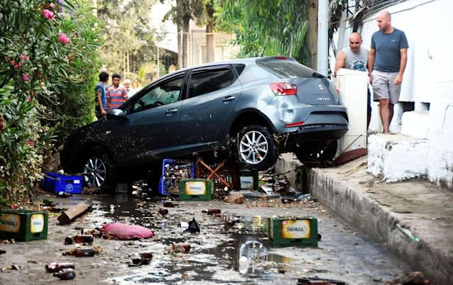 <p>A car, damaged on the overnight earthquake is seen in Bodrum, Turkey, Friday, July 21, 2017. (Photo: DHA-Depo Photos via AP) </p>