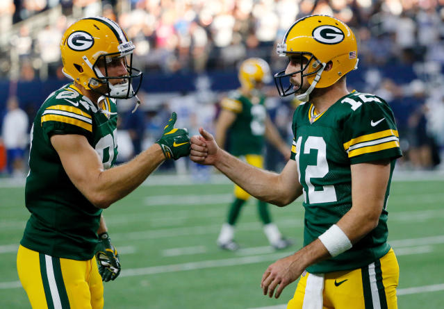 FILE - In this Oct. 8, 2017, file photo, Green Bay Packers' Jordy Nelson (87) and Aaron Rodgers (12) celebrate a touchdown late in the second half of an NFL football game against the Dallas Cowboys in Arlington, Texas. An offseason of change for the Packers has been met with occasional displeasure by Rodgers. (AP Photo/Roger Steinman, File)