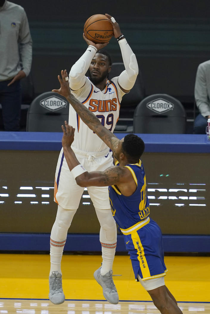 Phoenix Suns forward Jae Crowder, top, shoots a 3-point basket over Golden State Warriors forward Kent Bazemore during the first half of an NBA basketball game in San Francisco, Tuesday, May 11, 2021. (AP Photo/Jeff Chiu)