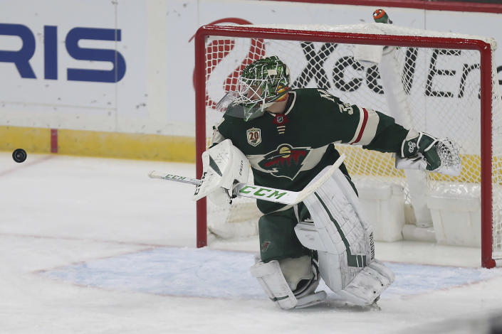 Minnesota Wild's goalie Kaapo Kahkonen watches the puck after he blocked a goal-attempt by the San Jose Sharks in the first period of an NHL hockey game Sunday, Jan. 24, 2021, in St. Paul, Minn. (AP Photo/Stacy Bengs)