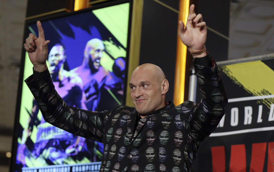 Tyson Fury, of England, who is scheduled to fight Deontay Wilder on Saturday for the WBC heavyweight boxing title, arrives at the MGM Grand on Tuesday, Feb. 18, 2020, in Las Vegas. (AP Photo/Isaac Brekken)