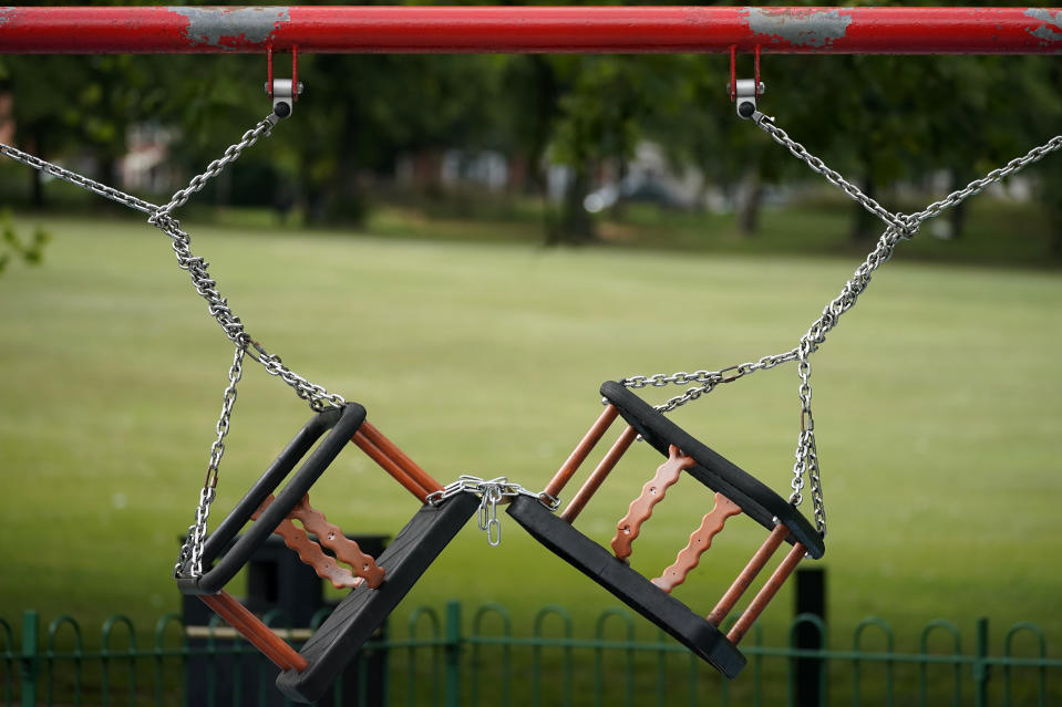 LEICESTER, ENGLAND - JUNE 30: Children's play swings remained locked and chained, due to the pandemic, in Spinney Hill Park before non-essential shops close for the localised lockdown on June 30, 2020 in Leicester, England. As the rest of England prepares to reopen pubs and restaurants this weekend, Leicester is closing all non-essential businesses again after a spike in coronavirus cases worried officials. (Photo by Christopher Furlong/Getty Images)