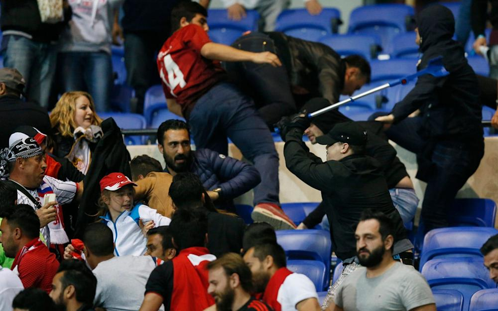 Besiktas and Lyon fans clash in the stands - Credit: Reuters / Robert Pratta