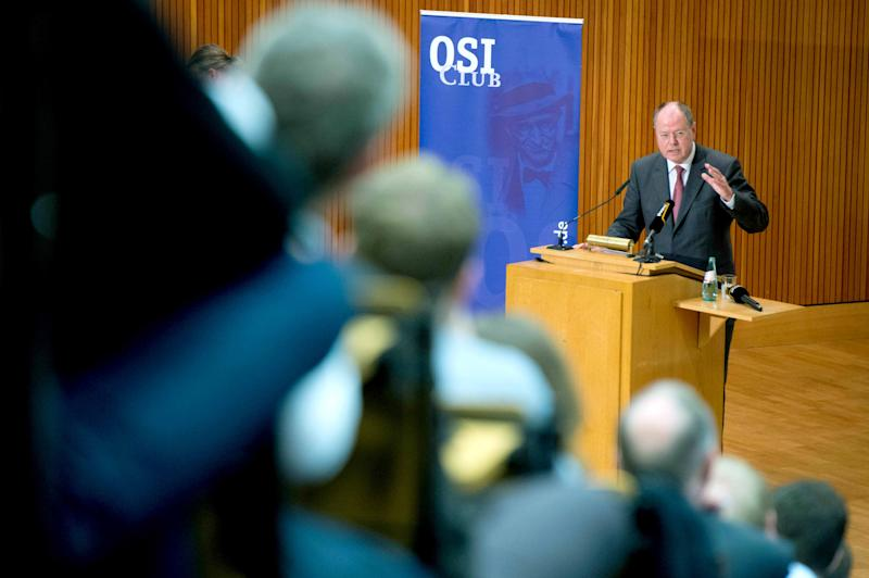 Chancellor candidate of the Social Democratic party, SPD, Peer Steinbrueck, delivers his speech on 'Guidelines of social democratic Foreign and Security Policy' at the Free University of Berlin in Berlin, Germany, Tuesday June 4, 2013. Chancellor Angela Merkel's challenger in the September national election said Tuesday that her government's insistence on budget austerity across Europe is creating economic stagnation and called for a new Marshall Plan to revive the continent. (AP Photo/dpa, Maurizio Gambarini)