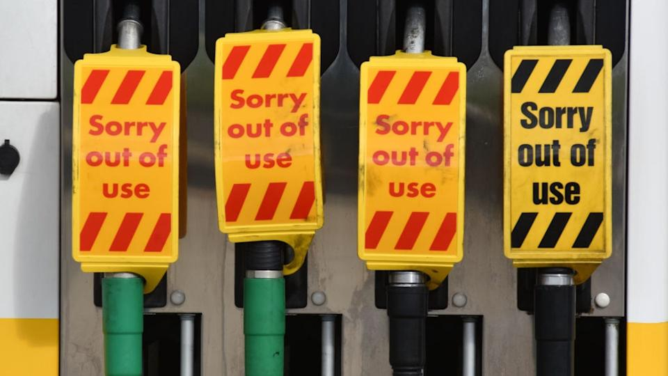'Sorry out of use' signs on petrol pumps.