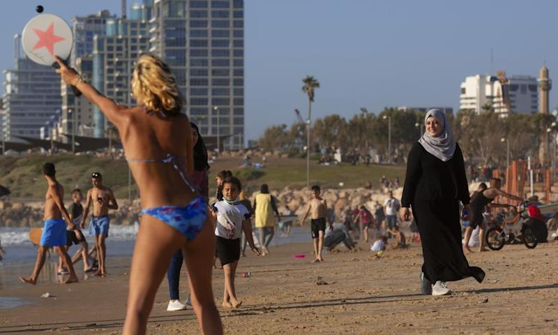 Palestinians and Israelis on the beach in Tel Aviv, Israel. Israel hopes it can revive its tourism industry by becoming a hub to replace Dubai or Doha.