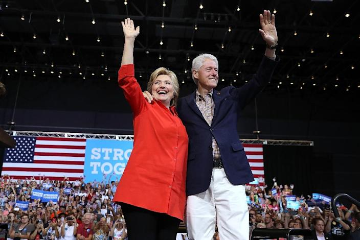 Democratic presidential nominee former Secretary of State Hillary Clinton and her husband former U.S. president Bill Clinton greet supporters during a campaign rally on July 30, 2016 in Pittsburgh, Pennsylvania (AFP Photo/Justin Sullivan)