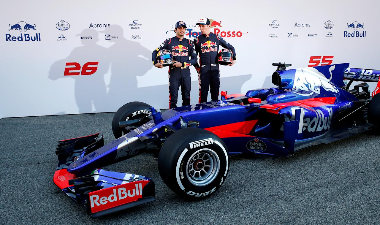 Spain Formula One - F1 - 2017 Toro Rosso STR12 Formula One Car Launch - Barcelona-Catalunya racetrack in Montmelo - 26/2/17. Toro Rosso's drivers Daniil Kvyat (R) and Carlos Sainz pose during the presentation of the new STR12 racing car. REUTERS/Albert Gea