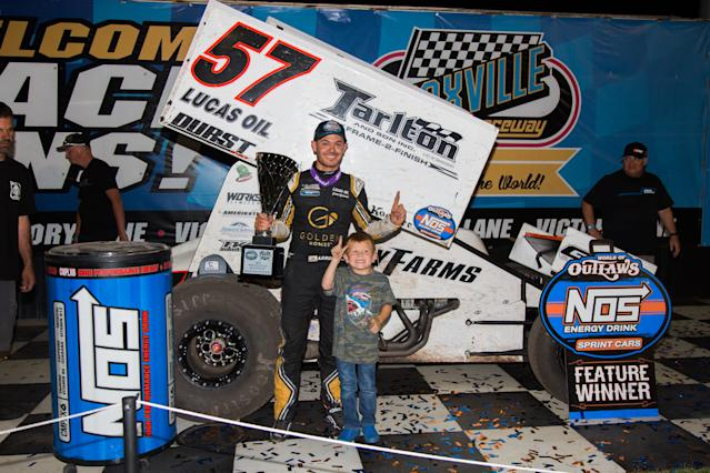 <em>Kyle Larson celebrates with his son, Owen, after his victory Friday at Knoxville Raceway (Trent Gower/World of Outlaws).</em>