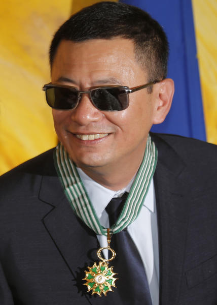 Hong Kong director Wong Kar-wai smiles after he received the Commandeur des Arts et Lettres from French Foreign Minister Laurent Fabius, in Hong Kong Sunday, May 5, 2013. Wong has been given France's highest cultural honor. (AP Photo/Vincent Yu)