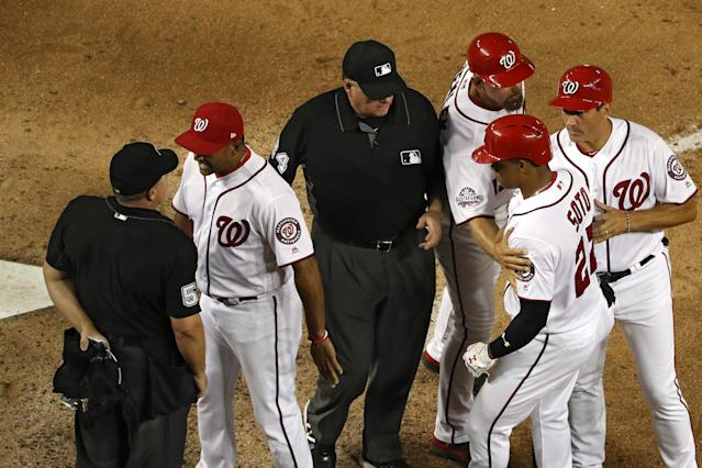 Nationals rookie Juan Soto is restrained after being ejected by umpire Greg Gibson. (Getty Images)
