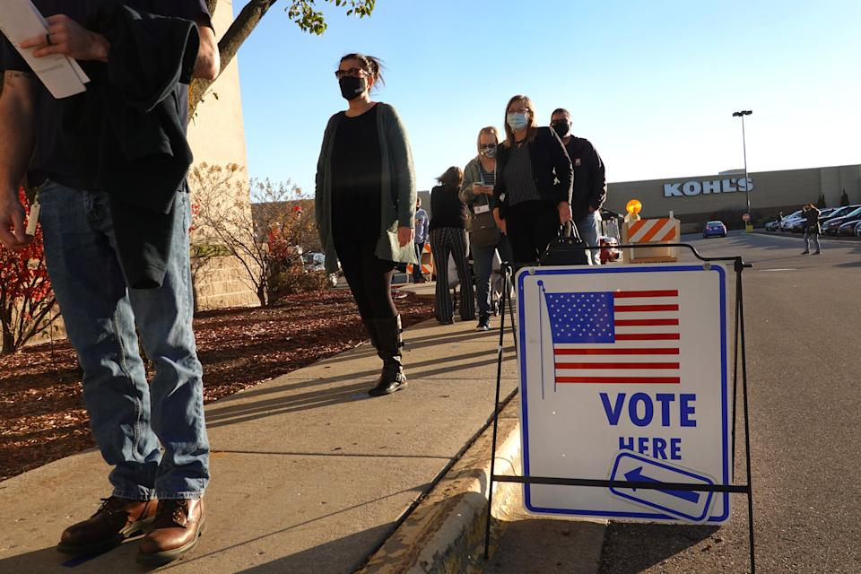 Residents wait in line to vote