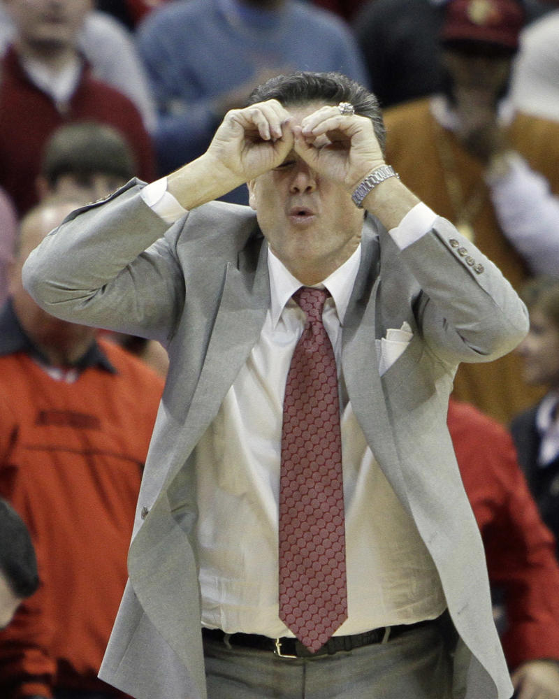 Louisville coach Rick Pitino reacts after a call in their NCAA college basketball game against Marquette in Louisville, Ky., Saturday, Jan. 15, 2011. No. 18 Louisville came from behind to beat Marquette 71-70. (AP Photo/Garry Jones)
