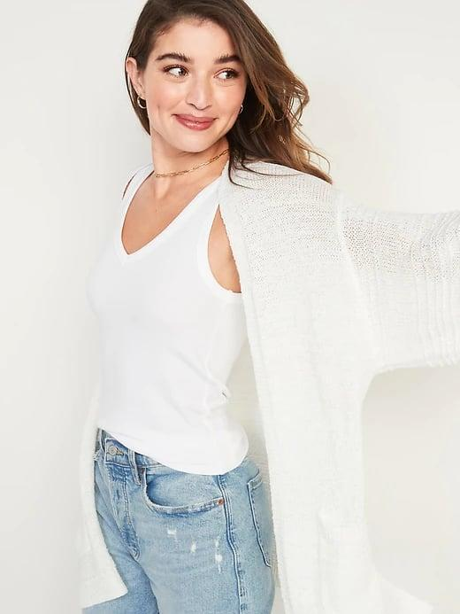 <p>With its bell sleeves and lightweight weave, we'd wear this <span>Old Navy Textured Open-Front Sweater</span> ($30, originally $45) in spring, summer, and through fall, too (especially in the burnt red hue).</p>