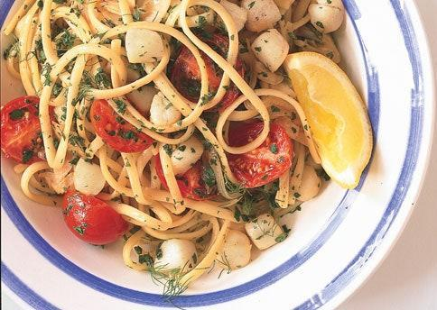 """The ultimate summer triple threat is this subtly fennel-flavored pasta. <a href=""""https://www.bonappetit.com/recipe/linguine-with-bay-scallops-fennel-and-tomatoes?mbid=synd_yahoo_rss"""" rel=""""nofollow noopener"""" target=""""_blank"""" data-ylk=""""slk:See recipe."""" class=""""link rapid-noclick-resp"""">See recipe.</a>"""