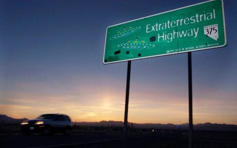 A vehicle moves along the Extraterrestrial Highway near Rachel, Nevada, the closest town to Area 51 - Credit: AP