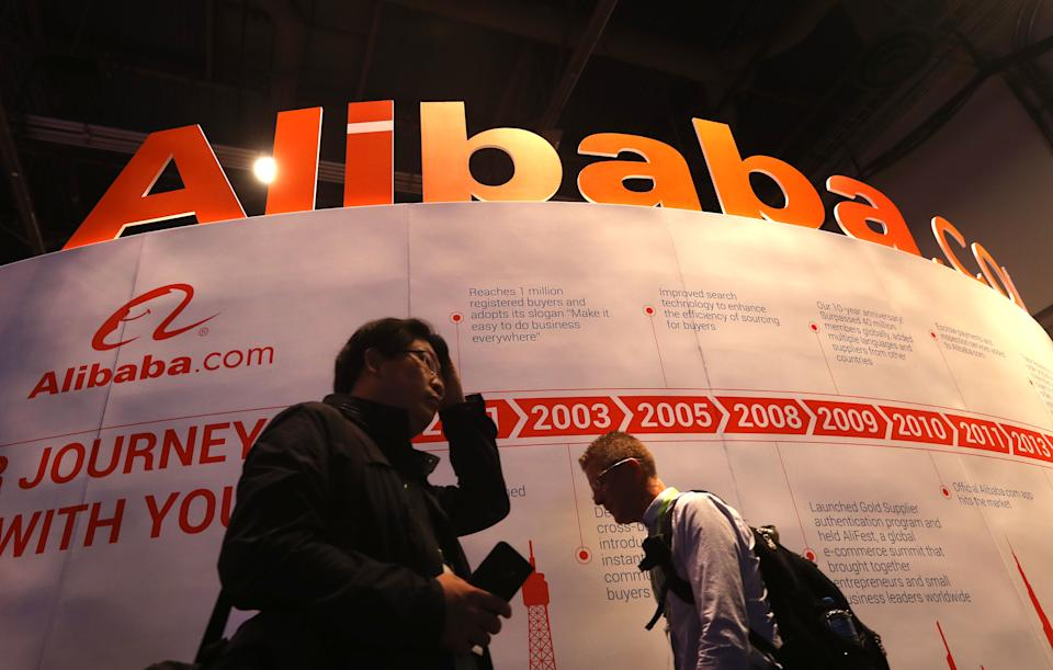 LAS VEGAS, NEVADA - JANUARY 09: Attendees walk by the Alibaba booth during CES 2019 at the Las Vegas Convention Center on January 9, 2019 in Las Vegas, Nevada. CES, the world's largest annual consumer technology trade show, runs through January 11 and features about 4,500 exhibitors showing off their latest products and services to more than 180,000 attendees.  (Photo by Justin Sullivan/Getty Images)