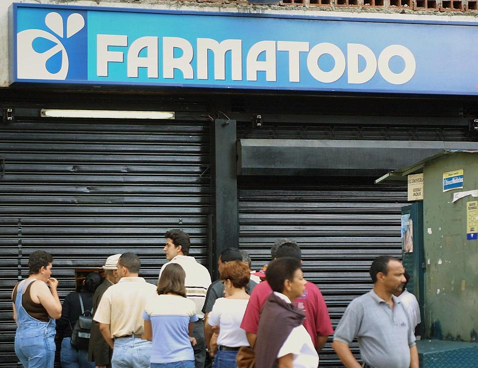 """Pedro Luis Angarita Azpurua, president of the Farmatodo pharmacy chain, and Agustin Antonio Alvarez Costa, his vice president, are accused of """"irregularities"""" in how they priced and stocked """"essential"""" goods at their stores (AFP Photo/Andrew Alvarez)"""