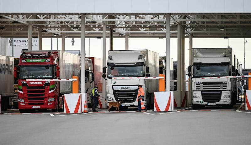 "An employee of Eurotunnel and his dog check trucks on their way to Great Britain during a day of test in case of Brexit at the entrance of the Channel tunnel in Calais, northern France on September 17, 2019. - British Prime Minister Boris Johnson on September 16, 2019 said there was a ""good chance"" of striking a Brexit divorce deal with the EU, following talks with EU chief Jean-Claude Juncker and Luxembourg's premier Xavier Bettel. (Photo by DENIS CHARLET / POOL / AFP) (Photo credit should read DENIS CHARLET/AFP/Getty Images)"
