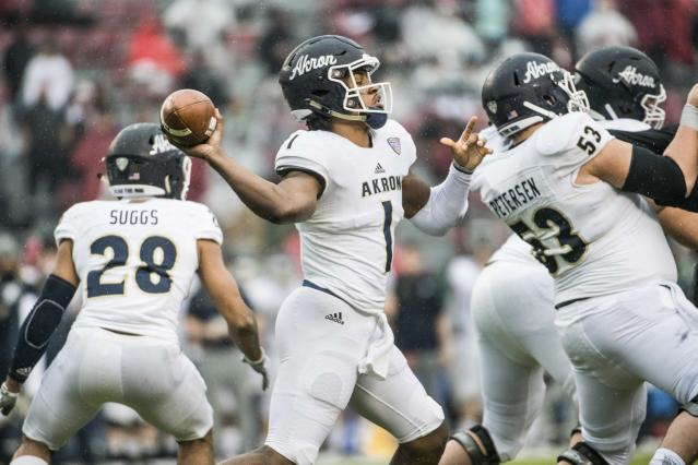 Akron quarterback Kato Nelson (1) attempts a pass during the first half of an NCAA college football game against South Carolina Saturday, Dec. 1, 2018, in Columbia, S.C. (AP Photo/Sean Rayford)
