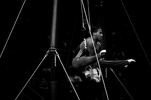 SAN JOSE, CA - JUNE 30: (Editor's note: This images has been converted to black and white) Joshua Dixon competes on the rings during day 3 of the 2012 U.S. Olympic Gymnastics Team Trials at HP Pavilion on June 28, 2012 in San Jose, California. (Photo by Ronald Martinez/Getty Images)