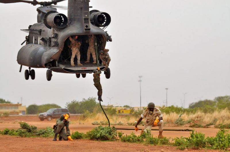 A 160th SOAR MH-47 crew trains local soldiers how to fast-rope.